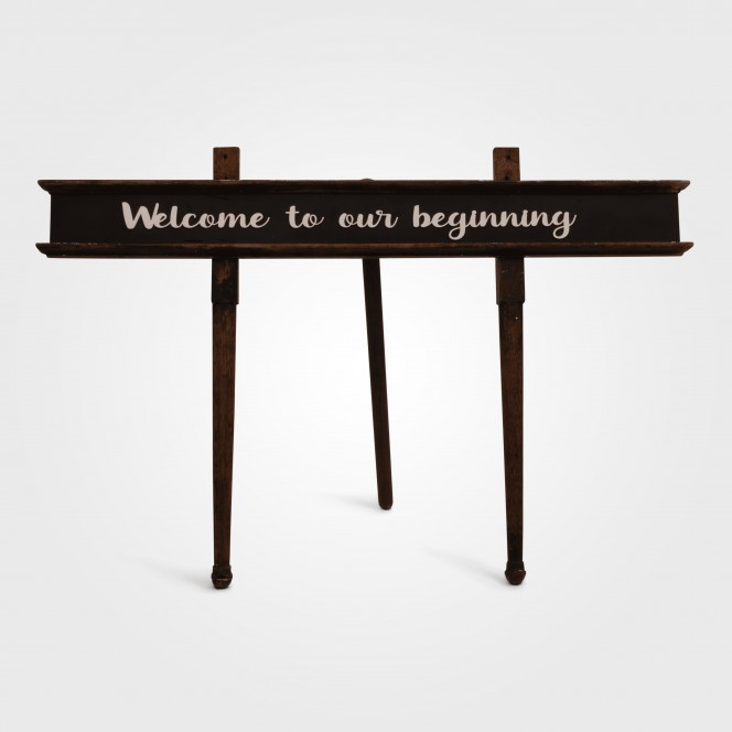 Sign - Welcome to our beginning on stand