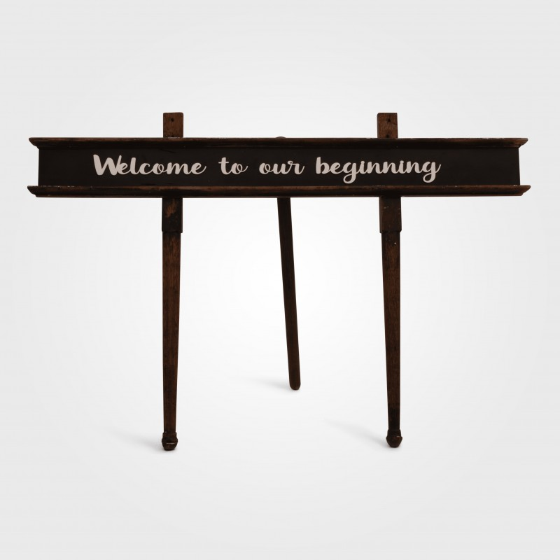 Sign - Welcome to our beginning on stand - Hero Image